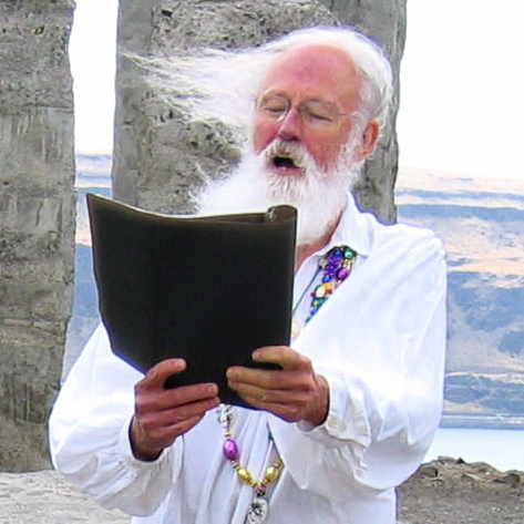 David Hedges reading at Maryhill Stonehenge. Photo copyrighted by Scottie Sterrett.